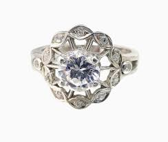 Flower Wedding Ring buy a hand made flower engagement ring with white sapphire made