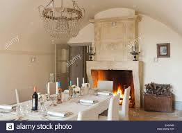 large open stone fireplace in vaulted dining room with 19th