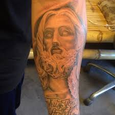 tattoos by lue pass on this religious sleeve and dove