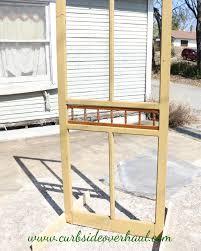 how to repurpose a screen door into a garden trellis curbside