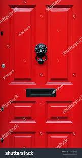 red front door closeup detail red front door london stock photo 131575712
