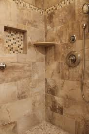 shower design with beige earth tone tile and mosaic accent and
