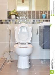 Modern Toilet by Water Closet With Hygienic Hand Spray In Modern Toilet Stock Photo