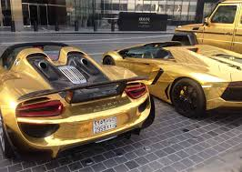 gold porsche 918 only in dubai would you see three gold supercars automotive99 com