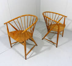 pair of sun feather arm chairs by sonna for nassjo