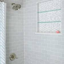 switch up the tile for the niche and have glass shelves