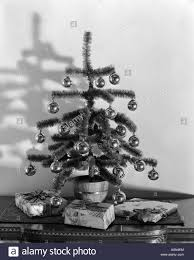 1940s small tree decorated with silver balls sitting on
