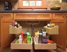 Liner For Under Kitchen Sink by Store Your Cutting Board Under Your Cupboard And Save Precious