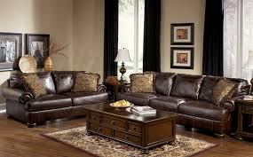 Living Room Sets Furniture by Axiom Walnut Living Room Set From Ashley 42000 Coleman Furniture