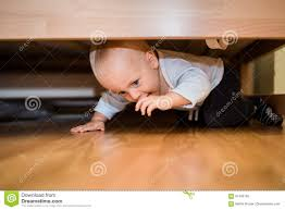 cute child playing under the bed stock photo image 91483165