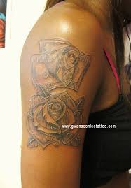 dollar bills money roses tattoo design on arm flower tattoos