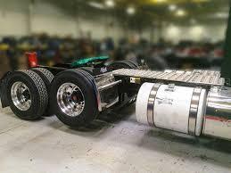 mack trucks mack trucks brings load logic 6 2 liftable pusher axle to mats