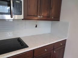 kitchen green glass tile backsplash with floating shelves and