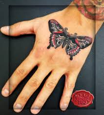 traditional sailor jerry butterfly on the tat by loop1974