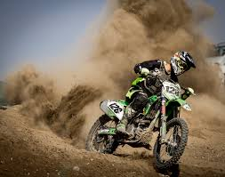 motocross bike sizes rider riding green motocross dirt bike free stock photo
