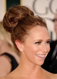 hair in a bun for women over 50 cute top knot hair bun picture for women over 50 latest hair