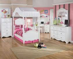 beige sisal rug and unique canopy bed for charming princess