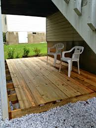 building a deck at ground level round designs