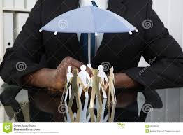 businessman holding umbrella over paper cutout people stock photo