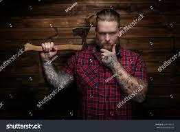 danger man holding axe wooden background stock photo 268745819