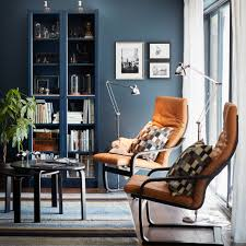 living room furniture ideas ikea a small livingroom furnished with two armchairs with natural coloured leather cushions and black