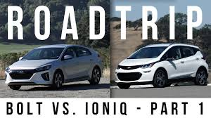 lexus parts vs bmw parts chevrolet bolt vs hyundai ioniq in a race around the bay part 1
