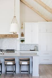 slim wall mounted kitchen cabinet stacked white shaker cabinets donning brass pulls are