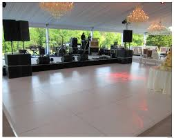 white floor rental stage floor rental peerless events and tents