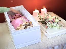 baby casket when a baby dies running to the darkness