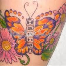 butterfly tattoo with baby footprint i have seen the baby feet tattoos but never one like this