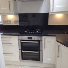 bosch built under double oven with gas on glass hob black
