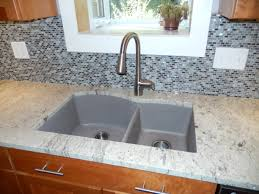 blanco silgranit sink in truffle stone glass mosaic backsplash