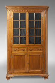 imposing tall corner cabinet with doors also inset face frame