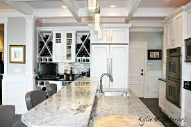 marble island with raised bar top wine bar station with white