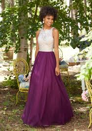 a line prom dress featuring a fully beaded bodice and soft net