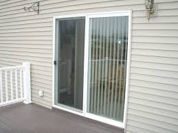 entrance wooden sliding patio door with white rool up window blind