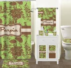 green and brown bathroom decor match the calming tones of green