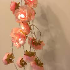 wild rose garland fairy lights in coral peachy pink bedroom