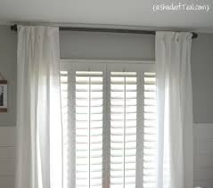 how to hang curtains properly diy wood curtain rod for under 20