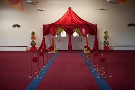 indian wedding hall entrance red flower decorations door tent