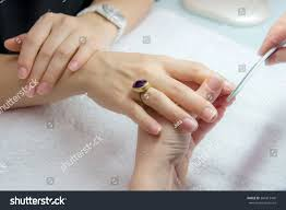 woman hands nail salon receiving manicure stock photo 384413449