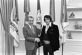 photograph of richard m nixon and elvis presley at the white house