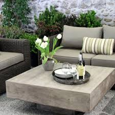 furniture floating concrete coffee table with beige sofa and