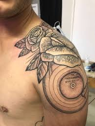 shoulder tattoo of roses bob dylan vinyl and record player arm