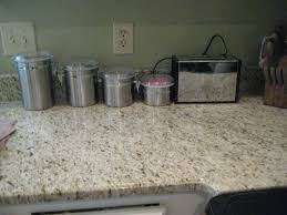 flooring mega granite with kitchen tools and white kitchen wall