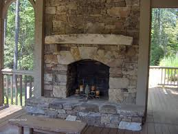 stacked stone fireplace with tv above on with hd resolution