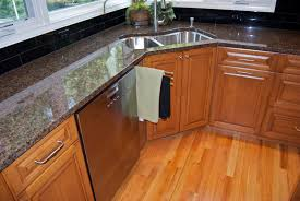 alder wood orange zest shaker door corner kitchen sink cabinet