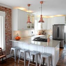 a simple industrial style kitchen with nautical copper pendant