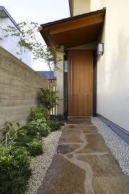 modern wood door designs add a warm welcome