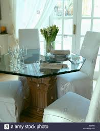 garage table and chairs white loose covers on chairs and hexagonal glass table in dining